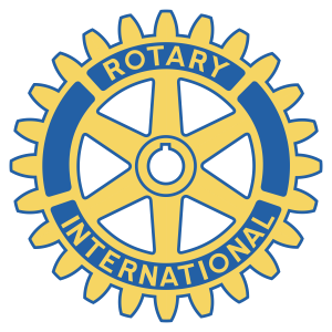 """This is a photo of the Rotary-Club logo. The logo is a blue and yellow wagon wheel with the word """"Rotary"""" written on top and the word """"International"""" on the bottom."""