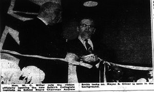 This is a black and white photo of Hon. W. C. Miller cutting the ribbon at th Selkirk Collegiate Institute opening in 1956., alongside Mayor S. Oliver.