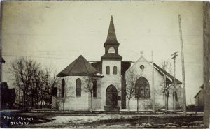 This is a black and white photo of Knox Church in 1909. The church is white and has a tall point above the entrance with stained glass windows.